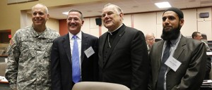 April 21, 2015 Doral ANA RODRIGUEZ-SOTO   FC Command Chaplain Col. Michael Lembke poses with most of the keynote speakers at the Religion Matters II conference, from left: Brian Grim, president of the Religious Freedom and Business Foundation; Archbishop Thomas Wenski; and Imam Asim Hafiz, Islamic religious advisor to Ministry of Defence of the United Kingdom.